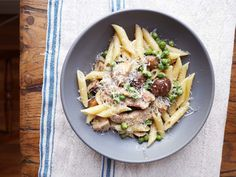 Goin' up on a Tuesday...with this umami-packed pasta dish. Get the recipe: Sautéed Chicken, Mushroom and Pea Penne Pasta