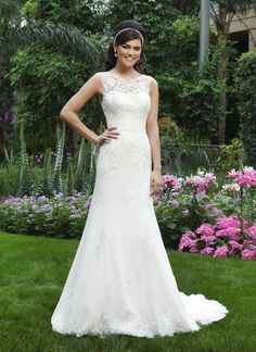 Sincerity wedding dress style 3730 A lace and tulle sheer Sabrina neckline and a chiffon cummerbund,  complement the chiffon mermaid skirt, that is accented with beaded lace  appliqués. This style has a V-back and buttons that cover the back  zipper and a chapel length train.
