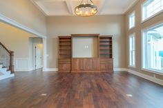Gorgeous wood work on the entertainment center. This is a beautiful open family room with plenty of natural light.