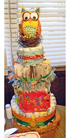 Love the baby books in the Diaper cake! Never would have thought of that -----Diaper Cake ideas Haugen Haugen Ricks Baby Shower Diapers, Baby Shower Cakes, Baby Shower Parties, Baby Shower Gifts, Diaper Crafts, Baby Crafts, Gift Crafts, Owl Diaper Cakes, Nappy Cakes