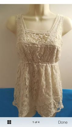 If only it had sleeves... Love all the different kinds of lace working together to make a pretty pattern that is still neutral. Perfect for dressing up or dressing down