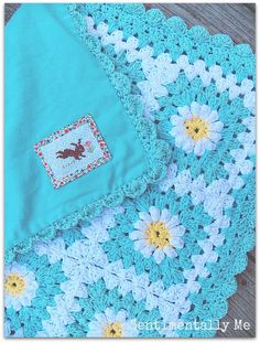 I love the idea of adding fabric to the back of a crocheted blanket for warmth :: Aqua Daisy Crochet Baby Blanket with fabric backing - idea only.