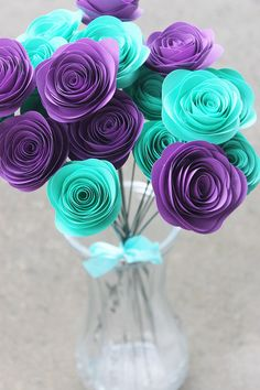 Craft teal and purple rosettes for a gorgeous bouquet that can sit on your Shimmer and Shine birthday party spread! The colors are reminiscent of the genie twins' outfits. This easy DIY craft will wow your preschooler and grownups alike!