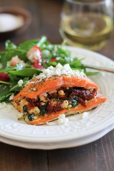 Serve this stuffed salmon with a side salad for a healthy meal.
