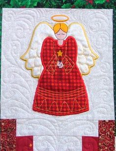 Christmas Quilt with applique angel.  Pattern and tutorial at Advanced Embroidery Designs.