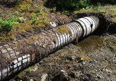 Old wood-stave pipes still in use to divert Carpenter Creek to the Silversmith Powerhouse in Sandon, British Columbia.