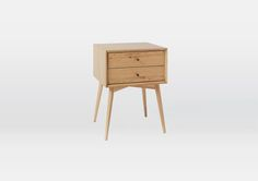 Inspired by American modern design, the Mid-Century Nightstand borrows its slim legs, angled face and understated retro details from iconic 50s and 60s fur