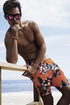 Mens Swimwear Trend: Get Graphic (Marc by Marc Jacobs' polyester swim trunks, Miansai bracelet's and Westward Leaning sunglasses.) [Photo by Renie Saliba]