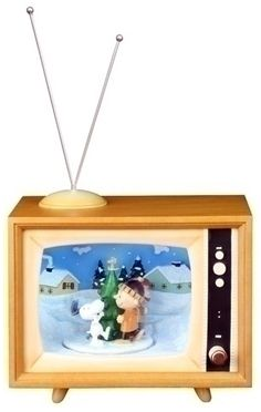 "Charlie Brown Christmas on TV (music box). Turn the knob on the TV and watch inside the TV. It lights up and the center, with Snoopy Charlie Brown and Linus, spins and plays Christmas songs. Stands 6.7"" tall, plus the antenna."