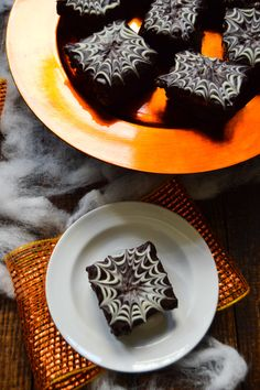 Halloween Brownies - rich, chocolate brownies with a decadent chocolate ganache and spooky white chocolate spiderwebs. Perfect for Halloween parties and gatheri