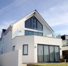 Frameless glass balustrade at a residential project. Supplied by Morris Fabrications Ltd. Glass Juliet Balcony, Juliette Balcony, Frameless Glass Balustrade, Mansions, House Styles, Gallery, Outdoor Decor, Cottage Ideas, Projects