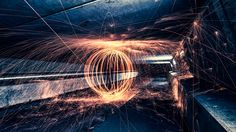 """Urban steelwool photography. The world looks different at night, and I like it. Here I created an orb with steelwool fire. Best viewed on black! If you like it you can follow me on <a href=""""https://facebook.com/martijnkortphotograph"""">Facebook</a> or via my <a href=""""www.martijnkort-photography.com"""">Website</a>"""