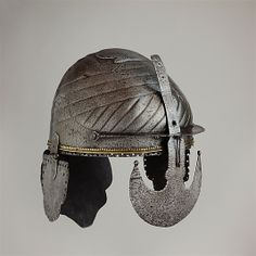 Helmet Date: 17th century Culture: Indian, Deccan, probably Bijapur Medium: Steel, copper-alloy Classification: Helmets Credit Line: Bequest of George C. Stone, 1935 Accession Number: 36.25.99