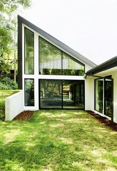 Renovated & extended all-glass basilica-roofed Mid 20th Century home.