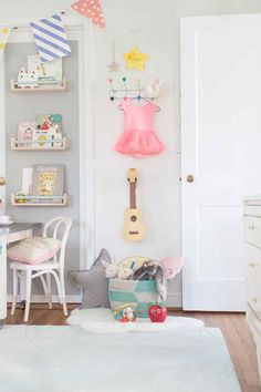 lay baby lay pastel baby room reveal. featuring our sheepskin cloud wool rug, washed velvet decorative star pillow and paint-dipped French café play chairs.