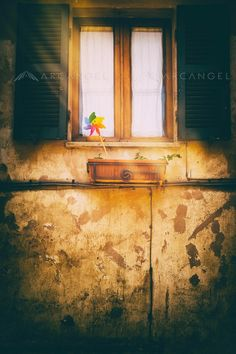 Window with shutters on a weathered wall by: Silvia Ganora #bookcovers #arcangelimages
