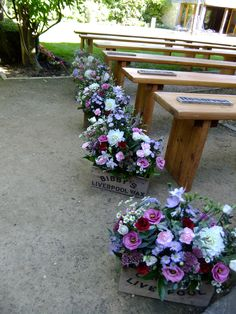 Pew ends of country garden flowers for an delightful outdoor wedding ceremony.  Flowers by Honey Pot Flowers.  Venue The Tythe Barn, Bicester, Oxfordshire