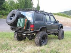 Awesome tire carrier design with room for jerry cans.