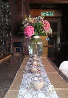 Flowers on the mantelpiece in the Lounge at an East Dene Wedding www.eastdeneiow.co.uk