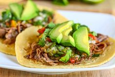 beef carnitas tacos made in the crock pot.  Easy and delicious!