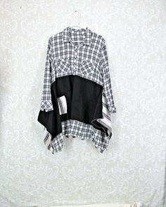 Beautiful Black Grey and White Upcycled Tunic that is very Flattering. Two patch pockets on Bodice and I added two to the skirt section. There is a light gold strip in the Flannel Print on the Bodice which I complimented using gold thread to secure the seams in a raised Serged Seam. Long Sleeve Flannel Bodice is perfect for this time of year and a One of a Kind addition to your closet. Bust: 21 inches lying flat or 42 inches around with slight stretch Hips: Full, Free, and Feminine and…