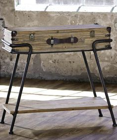 Suitcase Table.  I would flip out if that opened up still to use it for out of sight storage!!!!