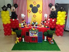 Dessert table and backdrop at a Mickey Mouse birthday party!  See more party planning ideas at CatchMyParty.com!