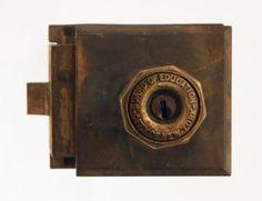 Cast bronze unit lock with board of education knob