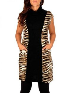 Vestido de pelo estampado animál salvaje sin mangas con frontal liso y cuello vuelto, composición 95% poliester 5% expandex. Talla única (M/L) http://www.aleko.kingeshop.com/Vestido-tigre-manga-hombro-dbaaaahXa.asp