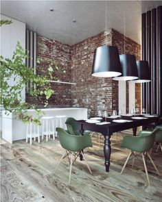 This Ukrainian penthouse has rustic, wide planked wooden floors and exposed brick walls with tall ceilings. Designed by Sergey Makhno, the dining room features a traditional black table with army green, dowel-leg Eames chairs and three massive black drum pendants for lighting.