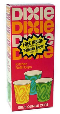 DIxie cups that were dispensed from a container hung on a bathroom wall.