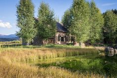 This Wyoming Home Made of Reclaimed Stone From an 1890s Dairy Barn Will Knock Your Socks Off