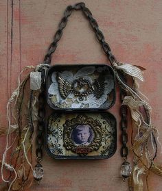 Altered Art Tin Assemblage...good idea for displaying altered tins.