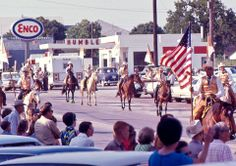 Did you know the rodeo is the official state sport of Texas? The 75th Texas Legislature made it official in 1997, though Texans have been enjoying the sport for decades. Case in point: this 1970 photo of a rodeo parade in the small town of Rising Star (southeast of Abilene), taken by Mike Fisher.  In the caption Mike explains that at the time Exxon was called Enco, and the lead cowboy was carrying a 48-star U.S. flag!