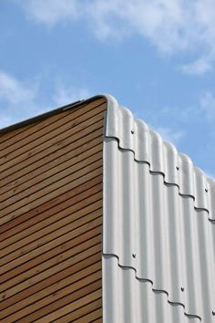 Corrugated fiber-cement panels wrap the roof and wall. Single-family House in Groharjevo / Roof Cladding, House Cladding, Metal Cladding, Wall Cladding, Cladding Materials, Roof Architecture, Architecture Details, Roof Replacement Cost, External Cladding