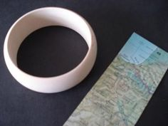 How to Make a Bangle from a Vintage Map - CraftStylish Victorian Jewelry, Vintage Jewelry, Vintage Maps, Jewelry Holder, Map Art, Home Furnishings, Bangles, Bracelets, Easy Diy
