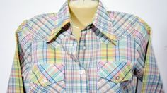 Like new! Western yoke. 2 button cuffs. Vintage permanent press blouse. Very pretty pastel plaid.   Measurements: Chest: 38 Sleeve length: 23 Shoulders: 16 Hips: 40 Length: 25.5