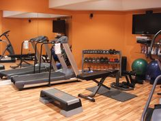 A motivating workout room. Minus the tv please!!!