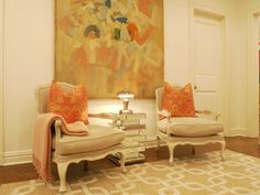 abstact painting, french chairs, mirror table and of course, orange pilows