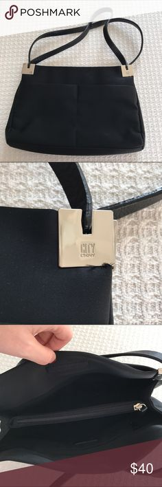 DKNY City Purse NWOT DKNY purse. This is a super cute purse that has magnets to hold the top closed. It also has a divider in the center with a zipper on top for those more important items. Feel free to ask questions or make an offer! DKNY Bags Shoulder Bags