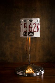 Brand Spankin' New: Double License Plates Lamps with vintage hubcap bases made in Texas. Currently available: Double - Alabama, Washington, California, Georgia, Mississippi on bourbonandboots.com.