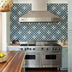 Bohemian kitchen featuring blue mosaic tile backsplash, stainless steel double oven, blue shaker cabinets, gold hardware and wooden countertops on the kitchen island Interior Design New York, Interior Design Inspiration, Design Ideas, Blue Backsplash, Kitchen Backsplash, Blue Kitchen Cabinets, Shaker Cabinets, Tv Cabinets, Kitchen Island