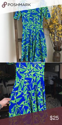 LulaRoe Nicole Dress -Bird Print! 🐦 Really beautiful, bright LulaRoe Nicole dress with sparrow print. So fun! Stretchy material is so comfortable and flattering on every body type. Used condition, priced accordingly. LuLaRoe Dresses Midi