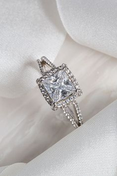 """EACH PIECE IS ADORNED WITH A BLUSH PINK SAPPHIRE """"LOVEMARK,"""" A NOD TO MONIQUE'S FONDNESS FOR THE COLOR, SYMBOLIZING THE BLUSHING BRIDE. MONIQUE LHUILLIER"""