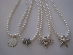 Pearl necklaces with silver charms
