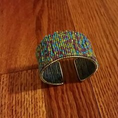 Beaded cuff bracelet Pretty spring colored beaded cuff. Barely worn. Beads are all intact and in blue, purple and green. Jewelry Bracelets