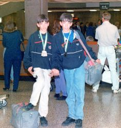 Not sure what's cooler...our bowl cuts or the dad jeans behind us! Lol.