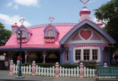 Minnie Mouse's House is absolute perfection. A craft room, sunroom, garden center and gazebo. I just need my own human version.