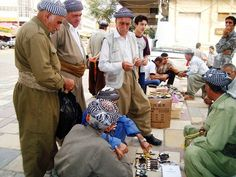Iraq – Kurdish men in the street of Duhok on May 20, 2010. RFE/RL