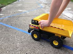 Make a road out of tape and have your children follow it with cars and trucks - bikes, too!